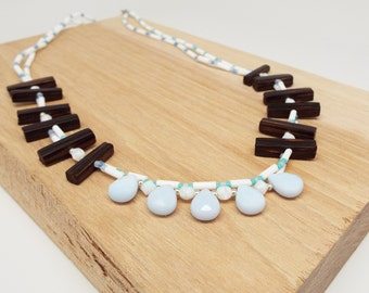 blue quartz teardrop briolette gemstone necklace with ebony wood modern graphic shape necklace double strand white and sky blue beads