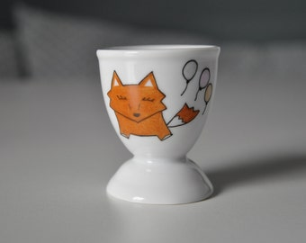 Fox and three balls on an egg Cup, custom avecun name on request