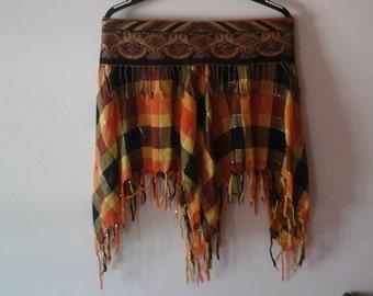 Orange plaid midi skirt with detailed belt waist.