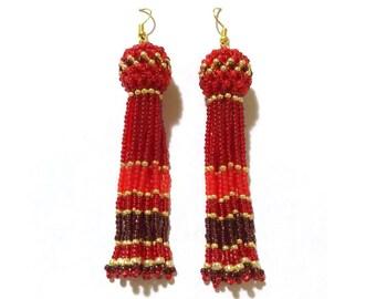 Long red beaded tassel earrings. Red gold earrings. Red tassels. Red beaded earrings. Red dungle earrings.