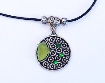 Moon crescent. Medallion with Swarovski crystals and sea glass