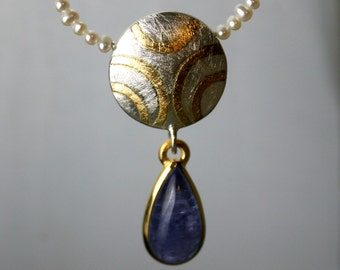 Necklace, necklace and earrings with tanzanite