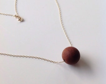 """Handcarved sapele necklace on a fine  9CT gold chain. 16"""" in length"""