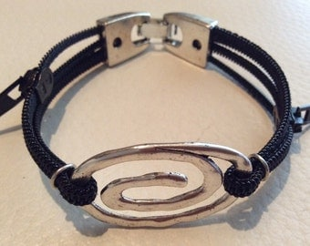 Bracelet with silver spiral zippers