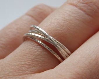 Silver fine and modern hammered ring with 4 interlace rings. for woman