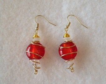 Red and white spiral earrings