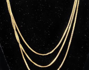 Multi-strand gold chain necklace