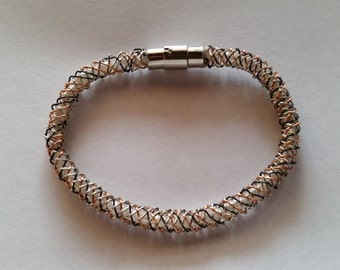 wirer bracelet with beads inside it clamp to close is magnetic