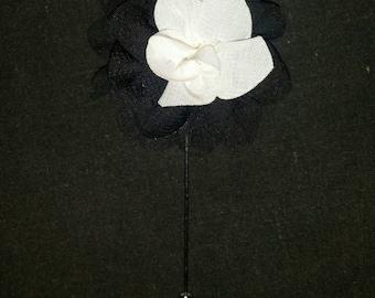 Black and white lapel flower