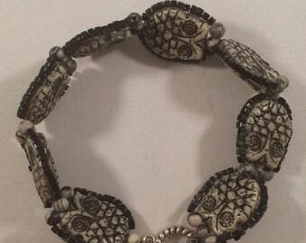 A parliament of owls bracelet.