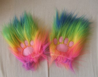Fake fur mittens in rainbow fur with paws