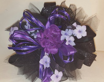 Purple corsage with boutineere