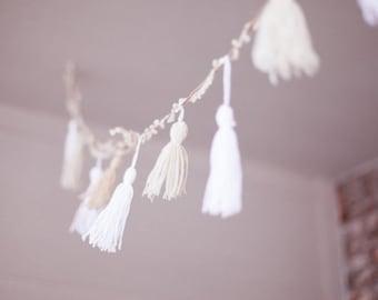 Yarn tassel garland, white, cream, and gold