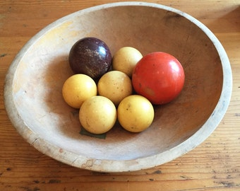 Five vintage yellow billiard cue balls, pool balls