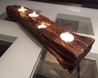 Natural wood log candle holder. This piece holds four tealights.