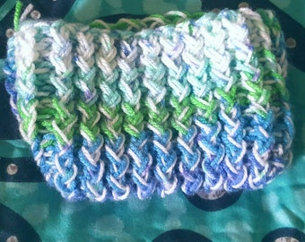 Cosmetic bag hand knitted with multicoloured blue and green and white wool