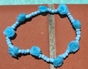 Stretchy turquoise clay flower bracelet