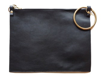 Black leather and brass bag