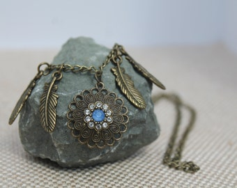 Feather and blue pendant necklace