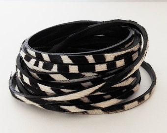 Black and white leather with fur like zebra 5mm sold by 20cm