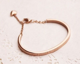 Rose gold bangle with Love Heart