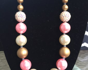 Creme, gold and pink
