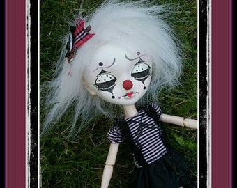 Girl doll, clown...