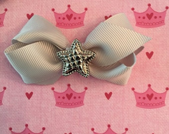 Hair bow with silver star charms