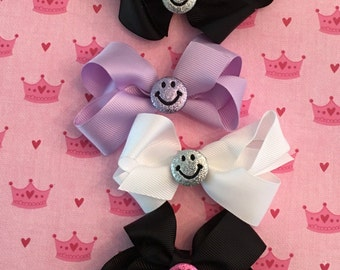 Hair bows with glittery smiley face charms