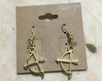 Gold bow and arrow earrings