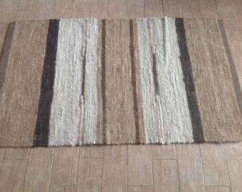 3' by 5' woven alpaca rug