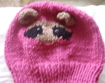 Pink knitted hat with small ferret face
