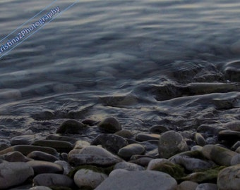 Calm water over rocks