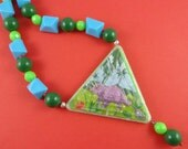 Big Dinosaur Necklace - triangle puzzle toy, chunky beads, green and blue, kitsch quirky cute, Harajuku Decora, repurposed toy, triceratops