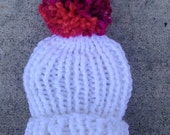 Chunky white baby hat with puff