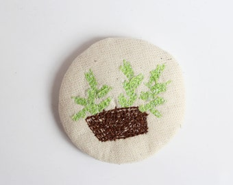 little animals pin - Green plant in a brown pot