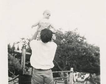 vintage photo 1939 from the back Father Holds baby up to the Sky