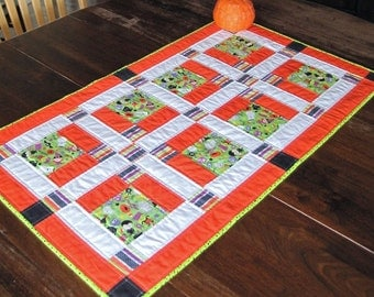 """Quilted table runner for Halloween. Orange and lime green fabrics. 23"""" x 40"""".  Riley Blake fabrics."""