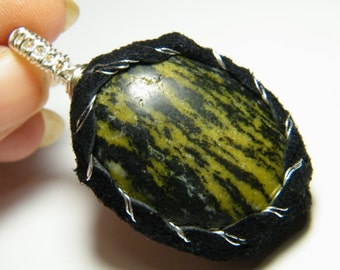 Natural Serpentine wrapped with leather, pendant