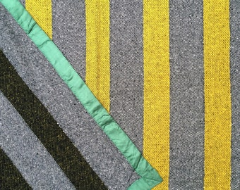 vintage green satin-bound striped yellow and gray wool throw / blanket