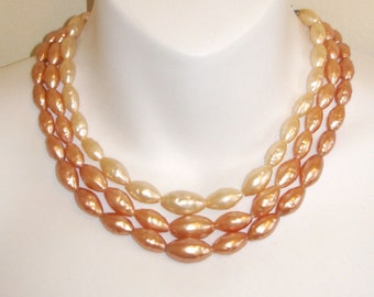 lovely vintage 3 strand peach pearls necklace HONG KONG