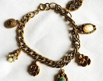 Vintage Charm Bracelet with 7 Charms Including Turtle, Pansy, Cameo, Rose, Fleur de Lis, Bee, and Oval with Red Stone Goldette Style (D3)