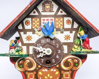 Tiny colorful cuckoo clock