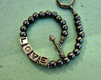 Beaded Toggle Clasp Bracelet with Hematite and Letter Beads: Love