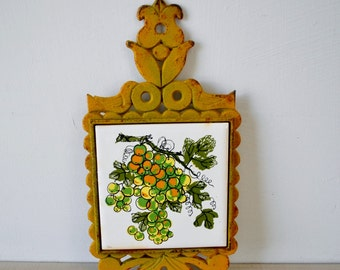 VINTAGE mustard yellow Cast Iron trivet with orange and green grapes and vines / vintage 1960s kitchen