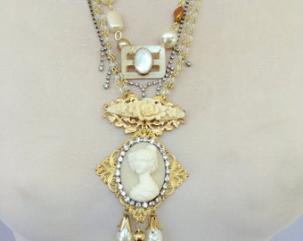 3 strand cameo and rhinestone necklace