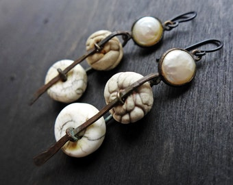 Achroous. White rustic assemblage earrings with pearl polymer and Nepalese naga conch.
