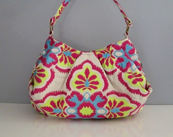 Large pleated shoulder bag fashioned in vibrant orchid fabric print