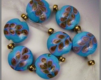 a set of 9 button or spree beads in turquoise with blue lavender and goldstone accents handmade lampwork glass - Sari