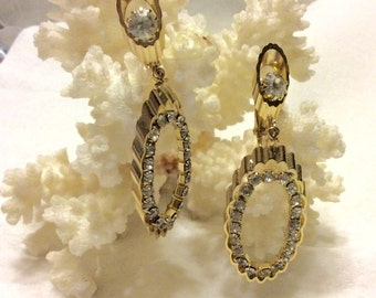 Gold metal drop dangle oval hoops with clear rhinestones earrings.